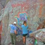 Photo of the Alpine Club of OKC members and FOW volunteers removing graffiti July 2018 at the Wichita Mountains Wildlife Refuge